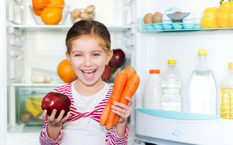 Girl smiling at healthy food
